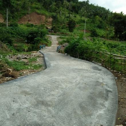 Pembangunan Jalan Beton Menuju Balai Serba Guna dari Dana BHP 2017